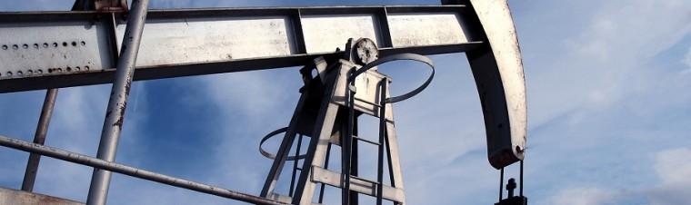 Silver Pumpjack In Crude Oil Field Mine